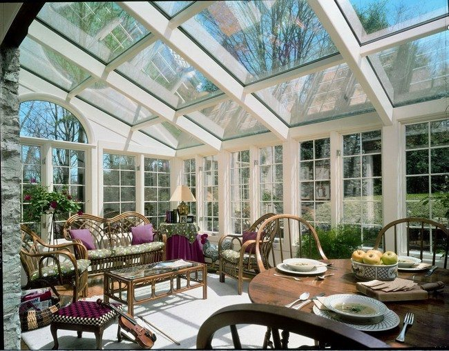 Extravagant Furniture Room Ideas Decor Around The World : uncategorized sunroom furniture idea with glass roof and white framed glass wall and wooden dining set along with retro style recliner chairs also glass top coffee table warmth and cozy sunroom decor from decoratw.com size 650 x 509 jpeg 107kB