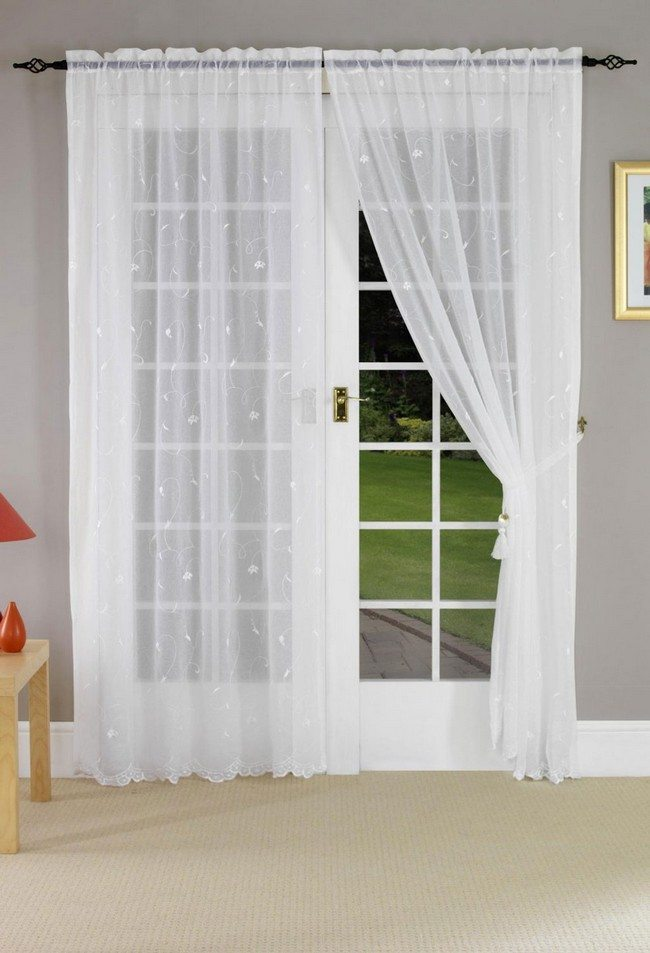 white wooden french doors with light lucid curtains