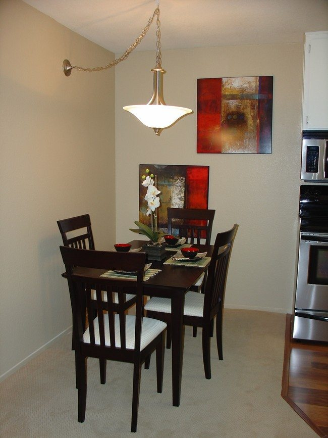 Small, Square Table. Elevated Dining Area With Wall Paintings