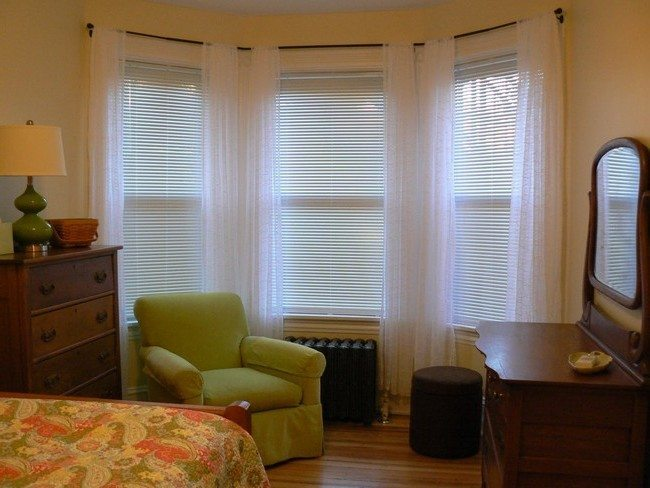 Bay window with horizontal paneling