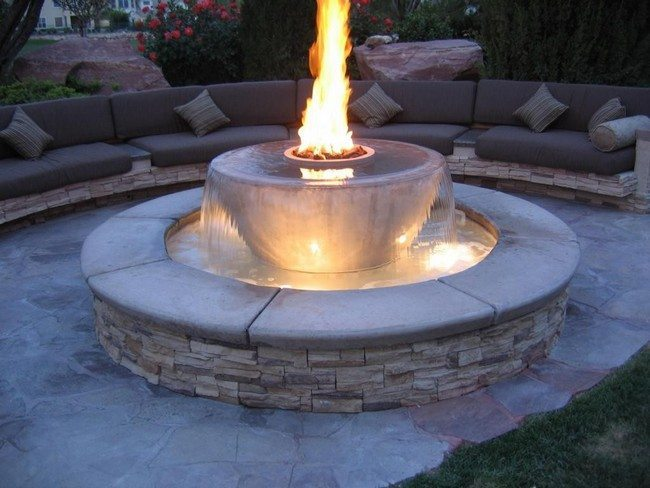 Water fountain with integrated fire pit