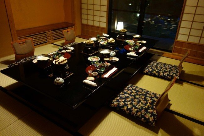 Asian-style table and floor cushions buy images