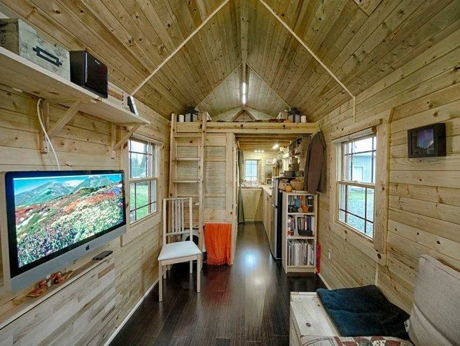 tiny house wooden house television mounted on wall