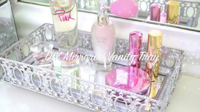 Mirrored vanity tray with a variety of beauty products