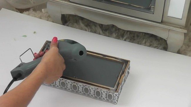 Placing the mirror into the frame
