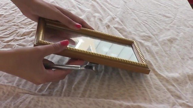 Small funky mirror in rectangular frame
