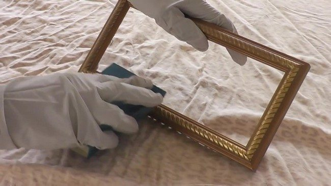 Sanding the frame using grit sanding block