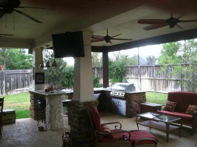 Large bar with cabinets and barbecue grill