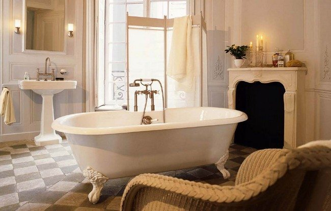 White clawfoot tub with long, gold faucet