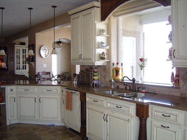 Long, overhead hanging lights hanging over kitchen counter