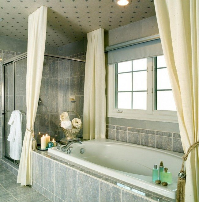 Bathroom with blue stone surfaces and large tub