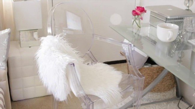 Sheep skin faux lelt covering glass chair