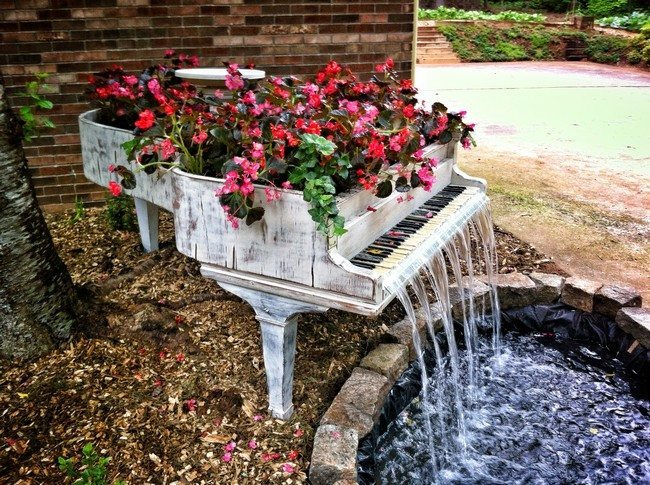 Piano with bright flowers used to create waterfall