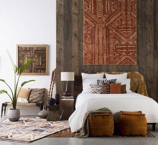 Simple patterned rug hung on wooden wall