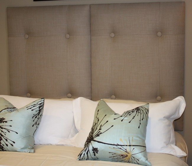 Neutral-colored tufted headboard