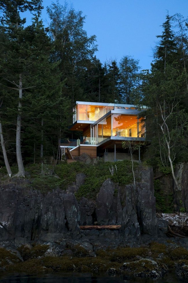 Cliff house surrounded by large trees