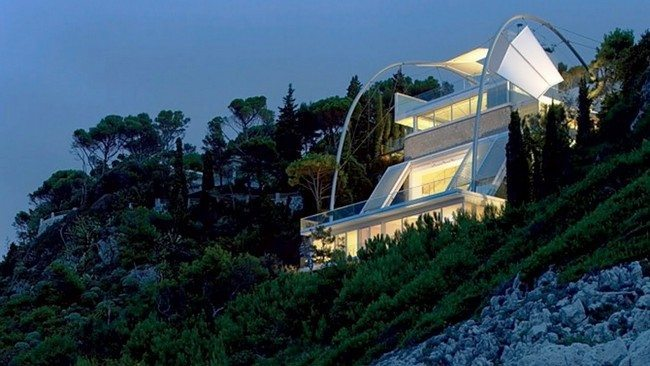 White, futuristic house with two balconies