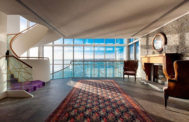 Large glass windows offering beautiful view of the water