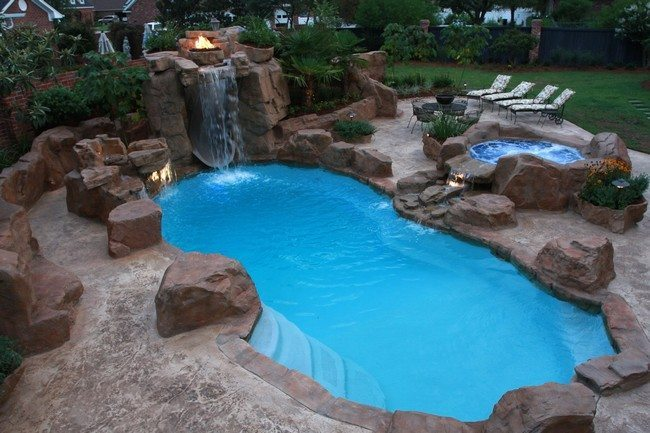 Pool waterfall with burning fire pit