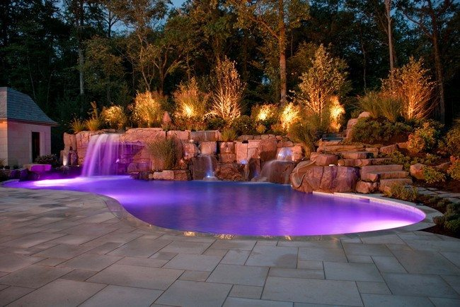 Pool waterfall combined with exotic lighting features