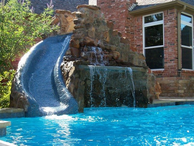 Swimming pool built adjacent to brick house