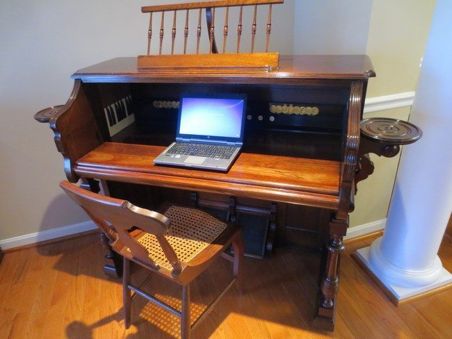 Repurposed wooden piano used as study/ workstation