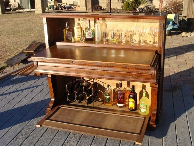 Repurposed piano used as a bar