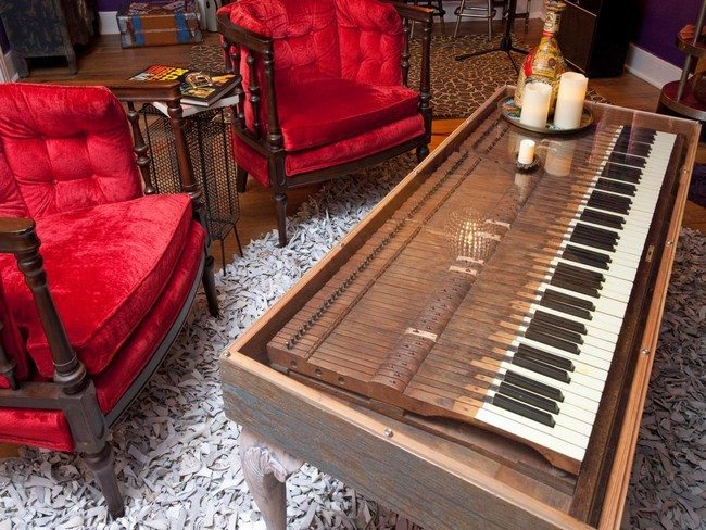 Long, wooden piano used as coffee table