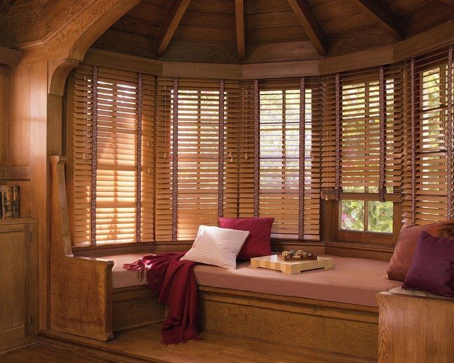 Wooden window seat with large, thick cushion