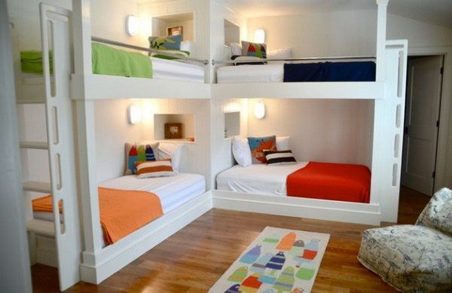 Beach-style kids' bedroom with twin bunk beds