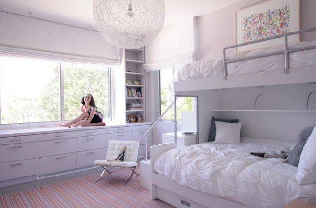 Contemporary girls' bedroom in white with plush bunk beds and contemporary lighting feature