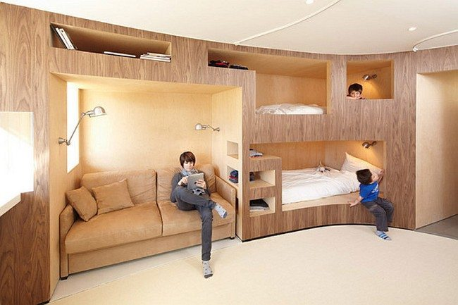 Innovative wooden wall with several bunk beds