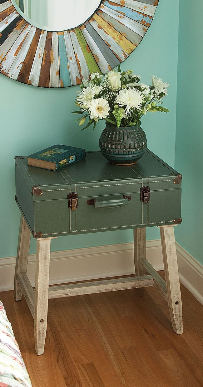 Vase of flowers displayed on top of repurposed suitcase