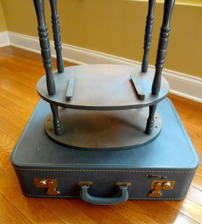 Blue suitcase on hardwood floor