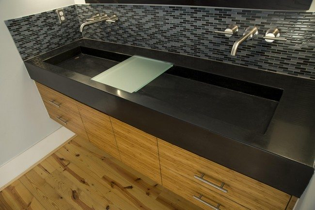 Large rectangular sink on top of wooden cabinet with drawers