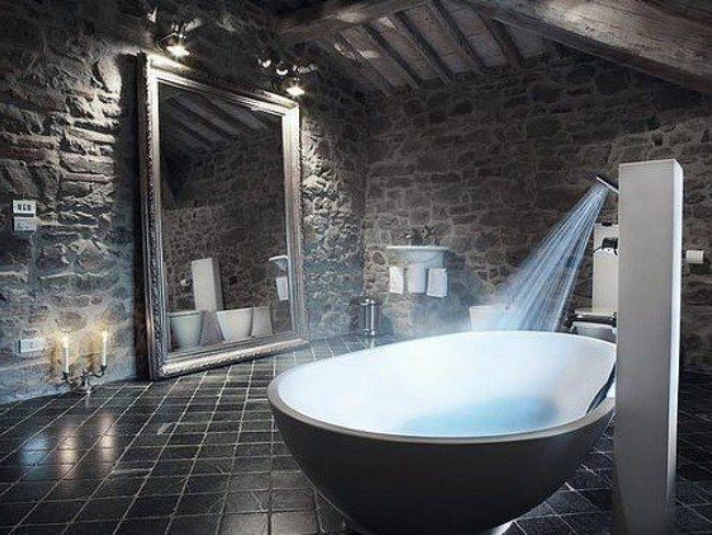 Bathroom with grey stone walls and floor