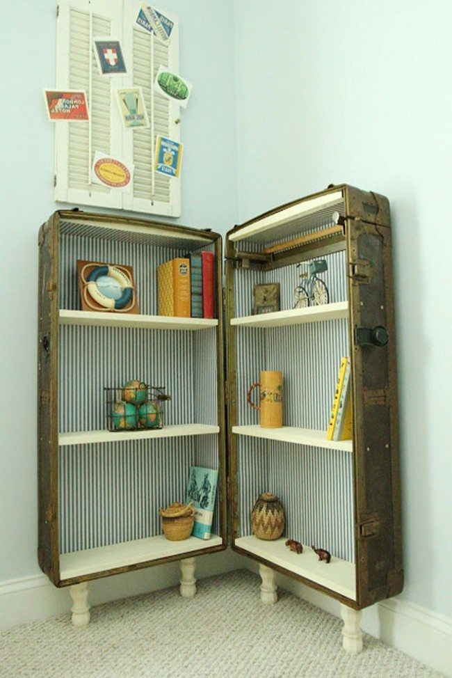 Large suitcase converted into storage cabinet with white shelves
