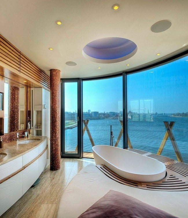 Bathroom with large glass doors surrounded by wooden deck