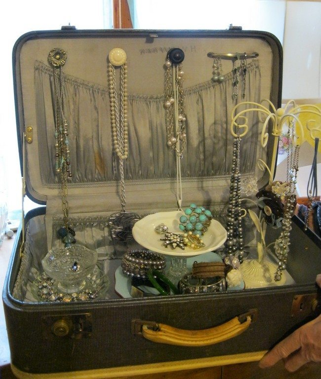 Old suitcase used for jewelry storage