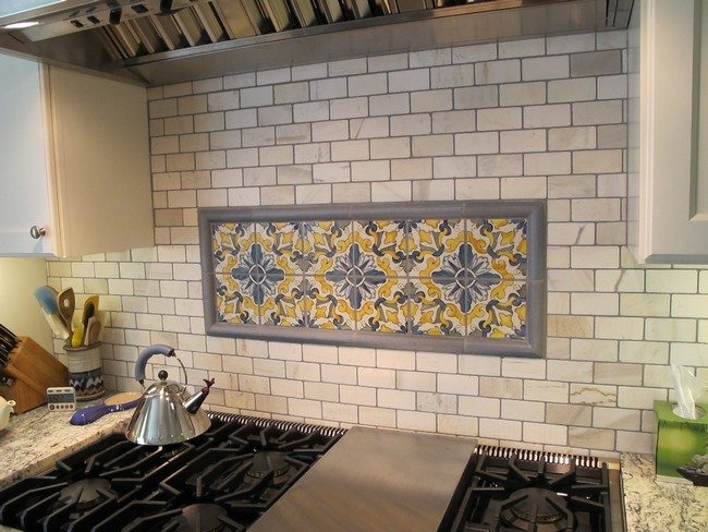 Painted Subway Tile Backsplash With Artistic Tile Detail In The Middle