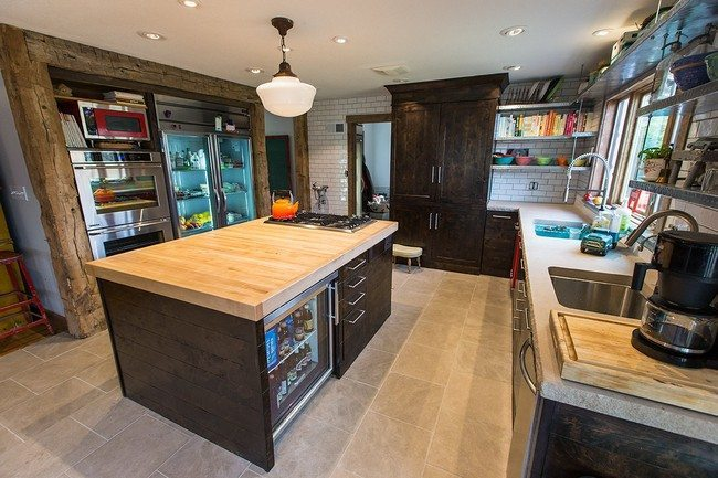 Contemporary island design with cabinets and tiny in-built refrigerator with a glass door for storing drinks