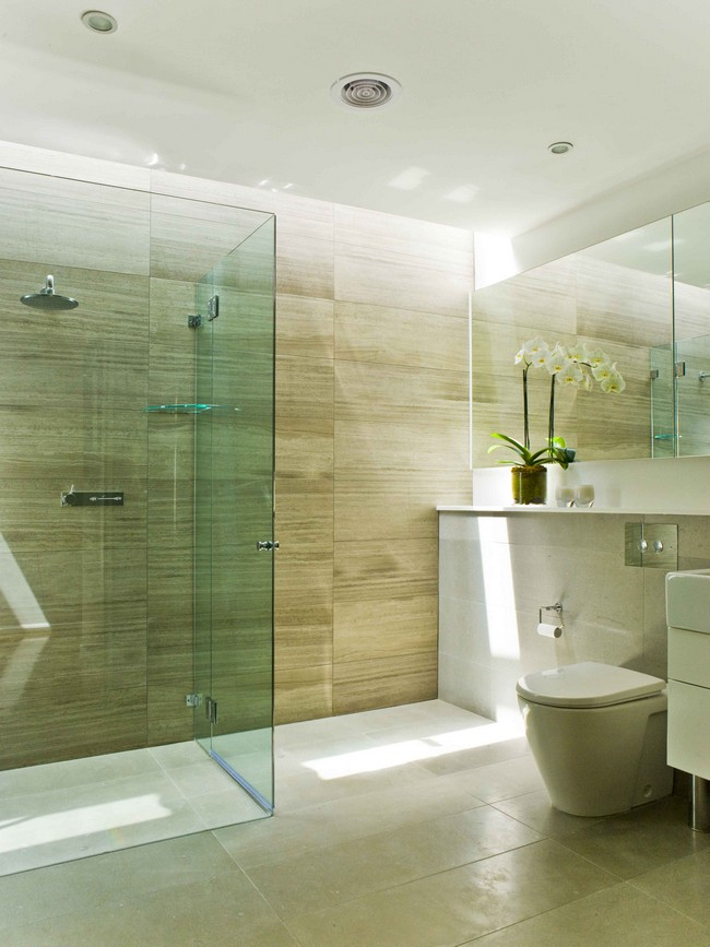 Contemporary bathroom with large, rectangular marble tiles