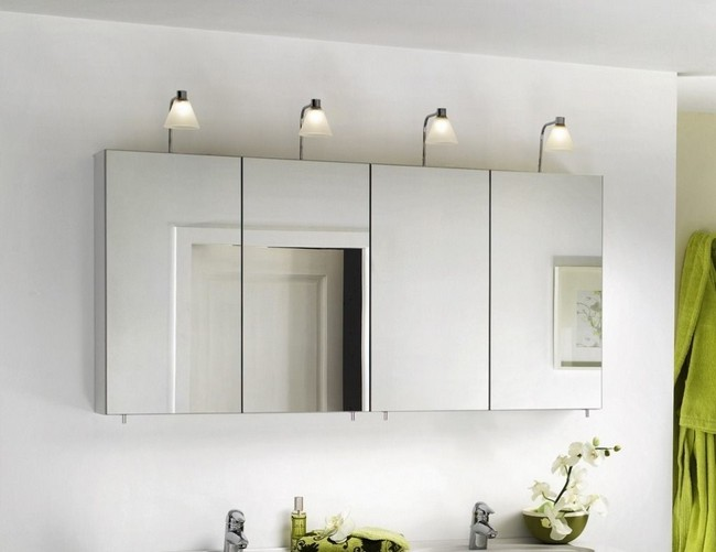 Series of contemporary bathroom cabinet mirrors beneath white lights