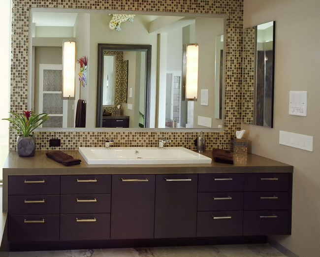 Large Mirror Placed Against Mosaic Tile Wall In Earthy Hues