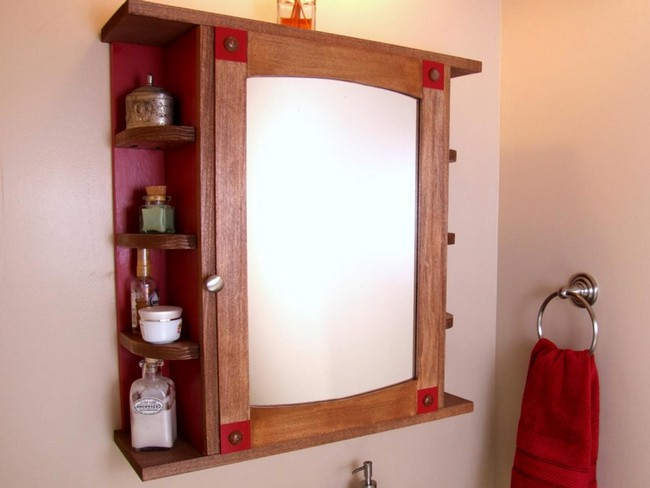 Mirror framed in wood acting as the cabinet door, with shelving on the side of the cabinet