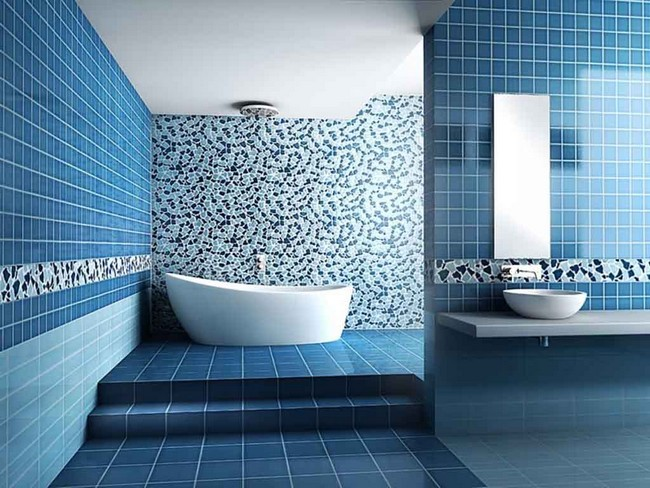 Small rectangular mirror on blue tile wall