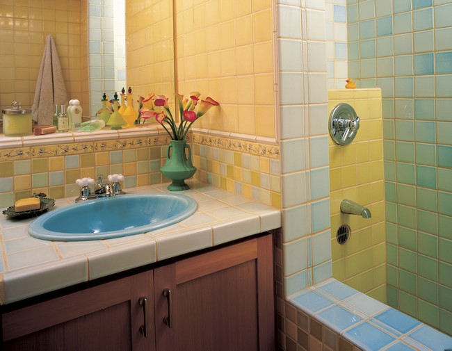 Mirror placed on colorful tile with different color variations