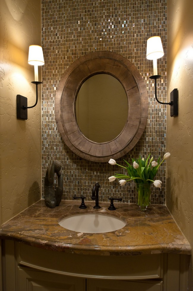 Round wall mirror with wooden frameplaced on mosaic tile wall