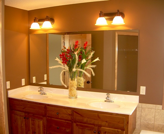Bright sconce lights above a large mirror