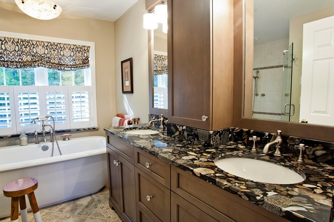Marble countertop with dark and light patterns matching those of curtain